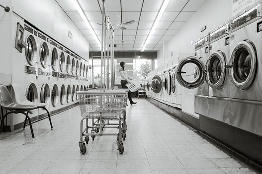 Interior of Laundromat with customer